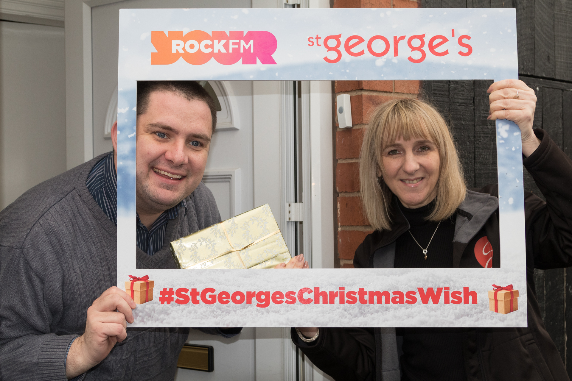 david-robinson-of-chorley-is-presented-with-an-ipad-by-nicky-horton-st-georges-office-mananger